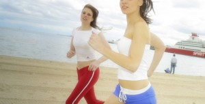 Two joggers on beach